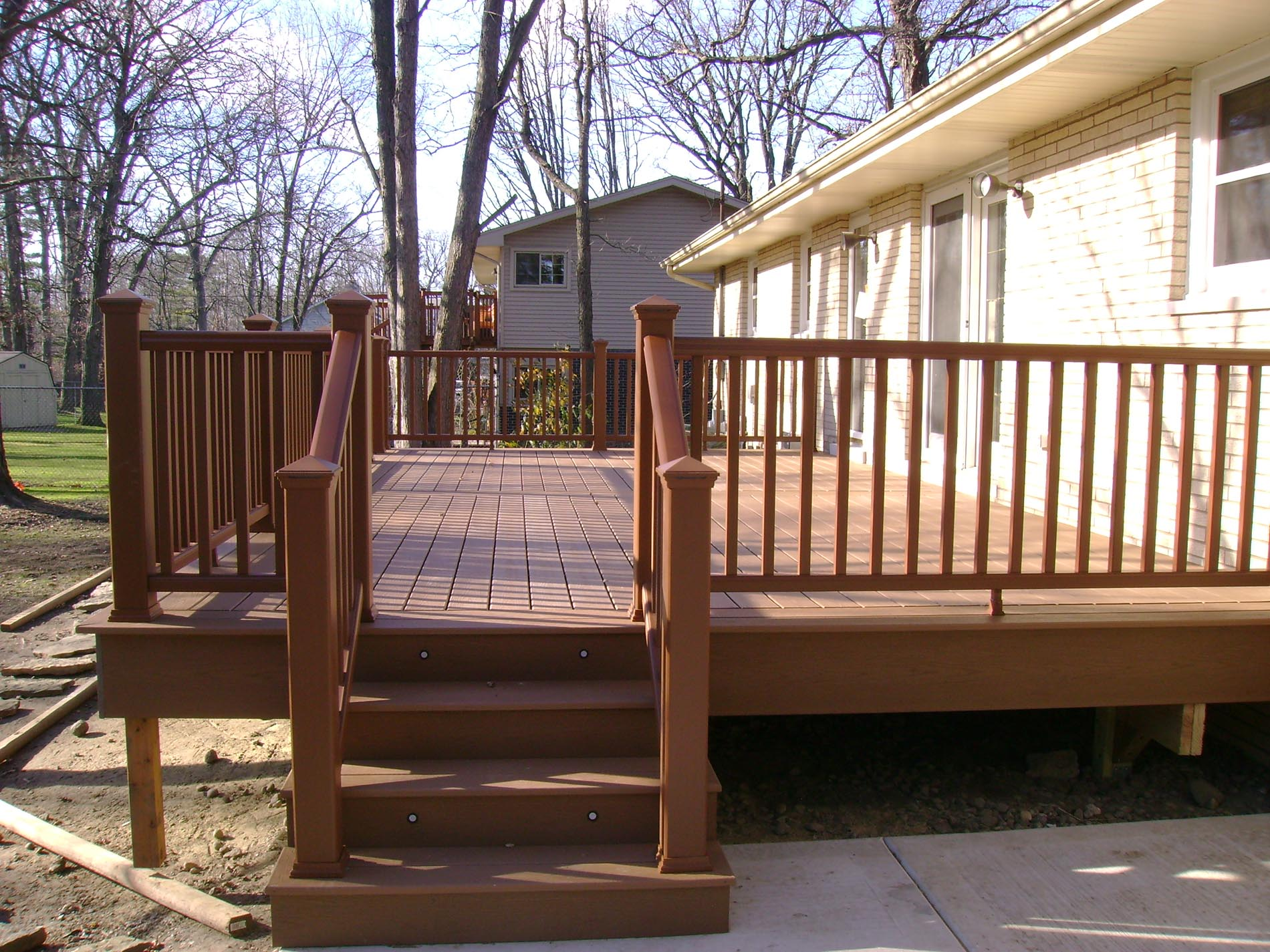 raised deck with stairs and lighting